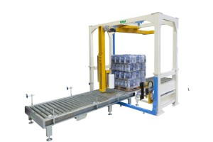 High speed rotating arm wrapping machine
